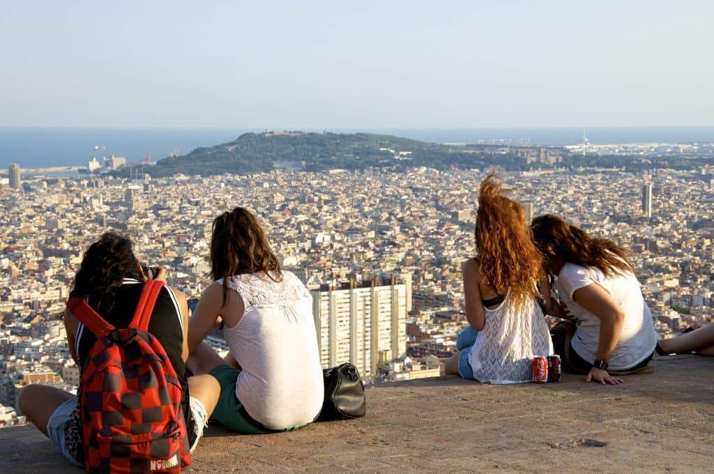 BARCELONA, SPAIN - AUGUST 23. Young people watch the skyline of Barcelona on August 23, 2013. With approx. 1.6 million inhabitants, Barcelona is the capital from Catalonia